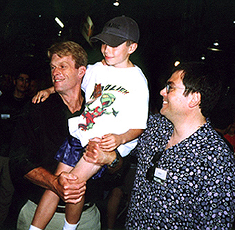 Kevin Conroy and Paul Dini with a fan at the Wizard World Chicago 1998. (Photo by Craig Crumpton)