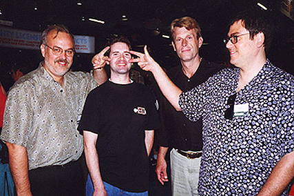 Alan Burnett, Craig Crumpton, Kevin Conroy, and Paul Dini do the 'Batusi' at Wizard World Chicago 1998. (Photo by Craig Crumpton)